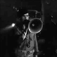 Small cropped capture forom Invasion of the Saucer Men, United States Air Force sergeant shouting at the alien ship through a megaphone