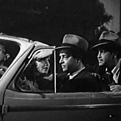 Small square crop from Noir film, They Made Me a Killer - the gang in the getaway car