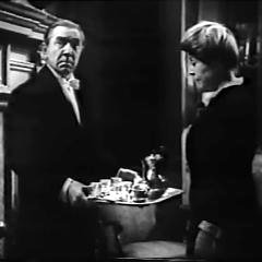 Square cropped capture from One Body Too Many, Bela Lugosi (Merkil) and Blanche Yurka (Matthews), Merkil Holding a Coffee Tray Between Them