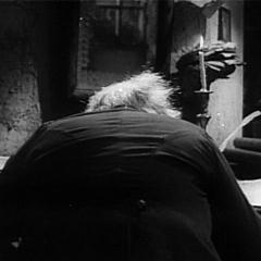 Cropped capture from Scrooge (Henry Edwards, 1935), Scrooge at his desk